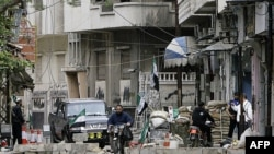 Kontrolni punkt sirijskih pobunjenika u Homsu, 160 kilometara severno od Damaska