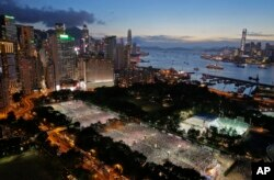 FILE - Tens of thousands of people attend a candlelight vigil at Victoria Park in Hong Kong to mark the 25th anniversary of crackdown in Tiananmen Square, June 4, 2014.