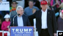 FILE - Then Republican presidential candidate Donald Trump (R) stands next to Senator Jeff Sessions during a rally in Madison, Alabama, Feb. 28, 2016. Sessions is a possible candidate for secretary of defense.