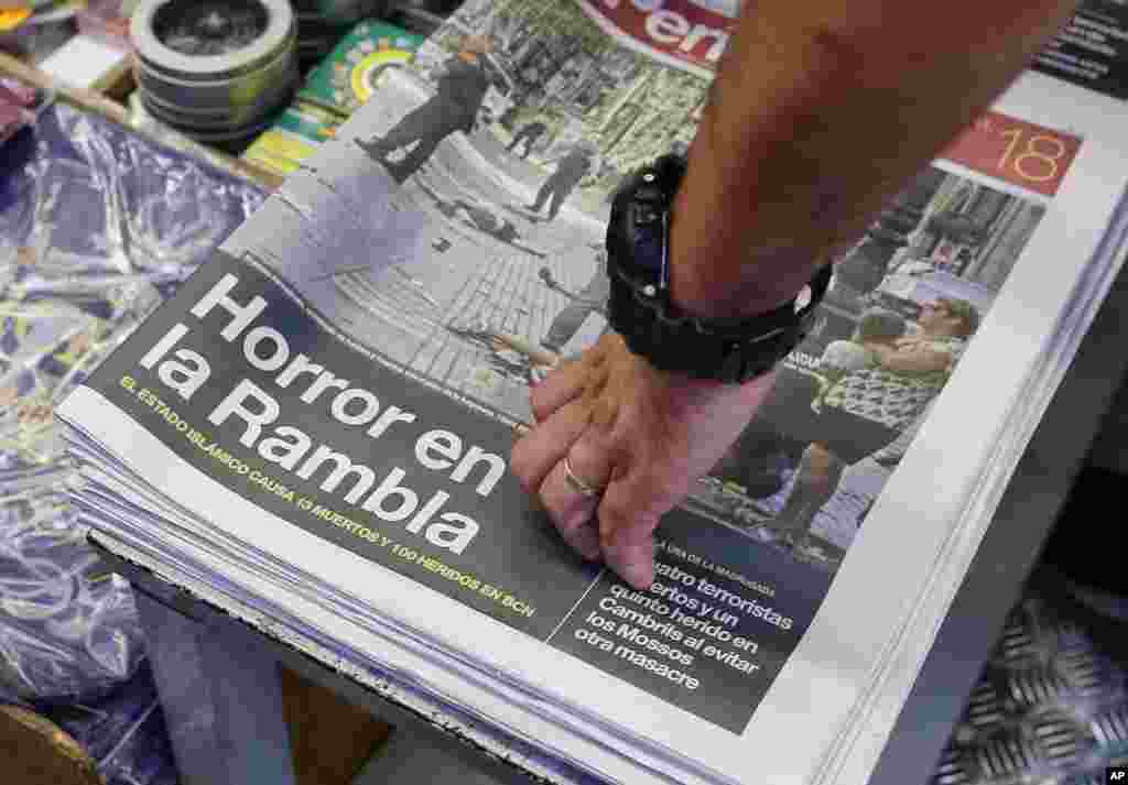 A newspaper displays a photograph of the aftermath of the terror attack in Las Ramblas, in Barcelona, Spain, Aug. 18, 2017.