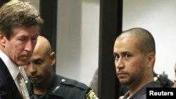 George Zimmerman (ຂວາ) ຜູ້ຕ້ອງສົງໄສ ຂ້າທ້າວ Trayvon Martin ເດັກໄວລຸ້ນອາຍຸ 17 ປີ
