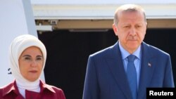 Turkish President Recep Tayyip Erdogan and his wife, Emine, arrive at the Tegel airport in Berlin, Germany, Sept. 27, 2018.