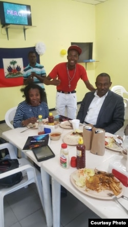 Pierre Lumps Benoit, in red, met with Haiti's ambassador to Mexico, Guy Lamothe, at right, over lunch in Mexicali this summer.