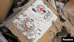 Damaged Red Cross and Red Crescent medical supplies lie inside a warehouse after an airstrike on the rebel held Urm al-Kubra town, western Aleppo, Syria Sept. 20, 2016.