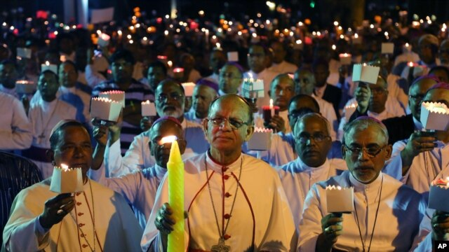 FILE - Catholic Bishops from different Indian states participate in a candle light vigil to protest attacks on churches in the Indian capital, as they assembled outside St. Antony's Church after attending the 27th Plenary Assembly of the Conference of Catholic Bishops of India in Bangalore, India, Feb. 6, 2015.
