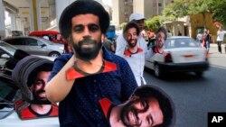 Vente de masques du joueur égyptien Mohammed Salah avant le match d'ouverture entre la Egypte et le Zimbabwe de la Coupe d'Afrique des Nations au Caire, en Egypte, vendredi 21 juin 2019.