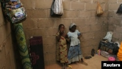 FILE - Children, who escaped Boko Haram attacks in both Michika and Cameroon, are seen inside an uncompleted house as they seek shelter in Adamawa, Nigeria, Jan. 31, 2015.
