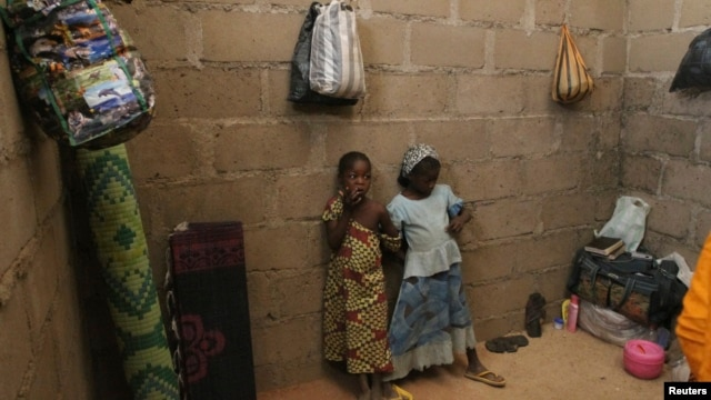 FILE - Children who escaped Boko Haram attacks in both Nigeria and Cameroon are seen inside an uncompleted house as they seek shelter in Adamawa, Nigeria, Jan. 31, 2015.