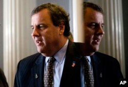 Republican presidential candidate, New Jersey Gov. Chris Christie talks as he meets with a supporter before a news conference, Jan. 25, 2016, in Concord, New Hampshire.