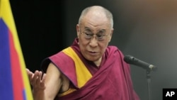 Tibetan spiritual leader the Dalai Lama delivers his speech during a seminar held by Japanese Diet members in Tokyo, Tuesday, Nov. 13, 2012. (AP Photo/Itsuo Inouye)