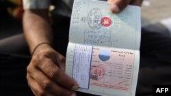 မွတ္တမ္းဓါတ္ပံု -၂၀၀၉ မတ္လတုန္းက ဘဂၤလားေဒ့ရွ္ ႏုိင္ငံကူးလက္မွတ္နဲ႔ Dubai visa ကိုင္ေဆာင္ထားတဲ့ ဘဂၤလားေဒ့ရွ္ ႏိုင္ငံသားတဦး