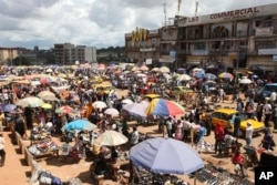 FILE - People shop at Mokolo market in Yaounde, Cameroon.