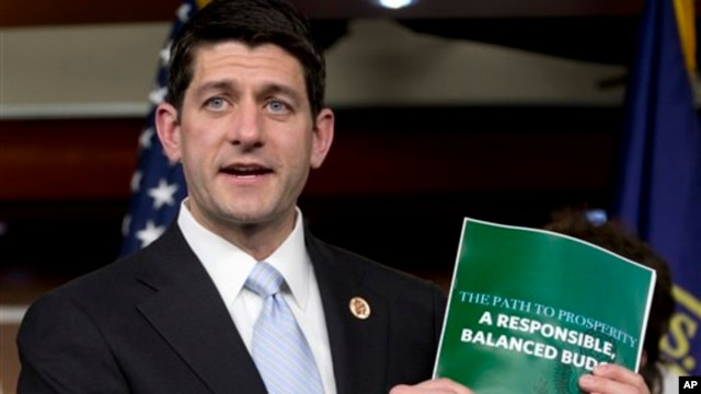 FILE- Congressman Paul Ryan holds a copy of the 2014 Budget Resolution, March 2013.