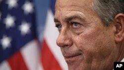 U.S. House Speaker John Boehner talks to reporters on Capitol Hill, Jan. 13, 2015.