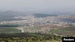 FILE - A general view shows the Kurdish city of Afrin, in Aleppo's countryside, March 18, 2015.