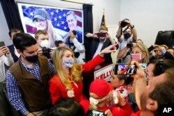 Republican candidate for U.S. Senate Sen. Kelly Loeffler gestures at a campaign rally in Marietta, Georgia, Nov. 11, 2020.