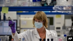 A lab technician works during research on coronavirus, COVID-19, at Johnson & Johnson subsidiary Janssen Pharmaceutical in Beerse, Belgium, Wednesday, June 17, 2020. Janssen Pharmaceutical hopes to begin clinical trials on a potential vaccine for…