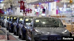 Tesla China-made Model 3 vehicles are seen during a delivery event at its factory in Shanghai, China, Jan. 7, 2020.
