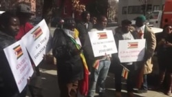 Angry Zimbabweans Protest ...