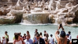 People gather in front of the Trevi fountain in Rome, June 28, 2021.