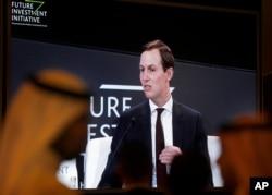 FILE - Participants watch U.S. White House senior adviser Jared Kushner on a screen during his speech in Riyadh, Saudi Arabia, Oct. 29, 2019.
