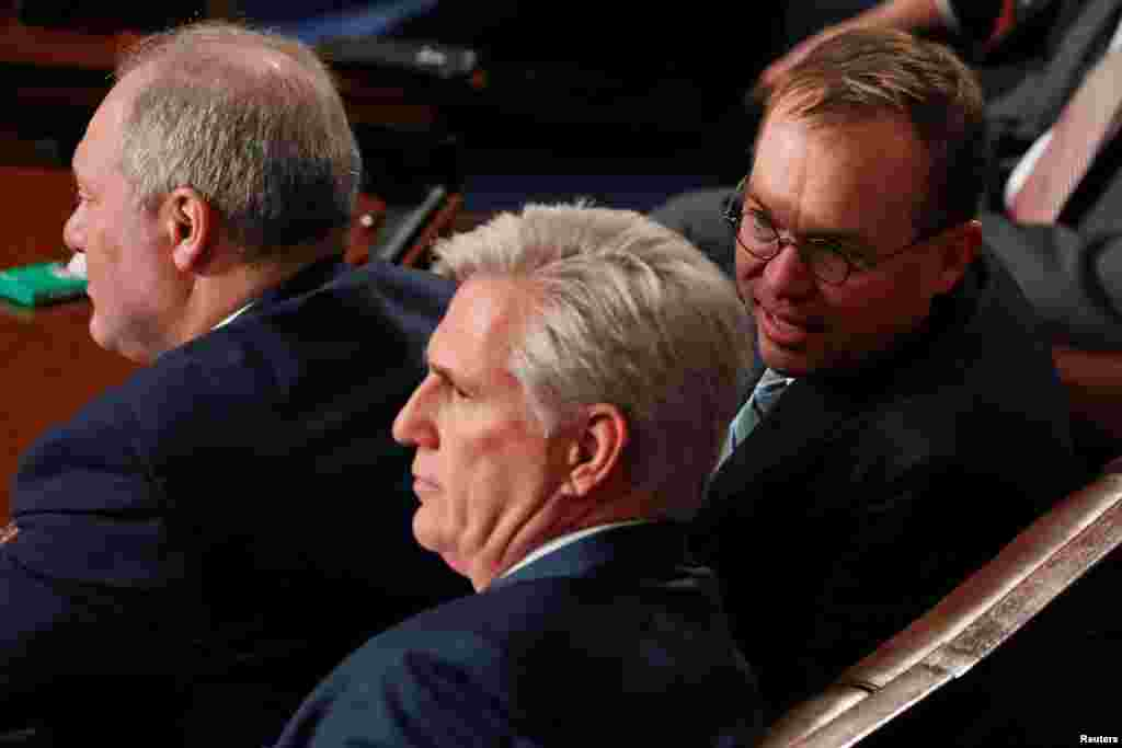 Acting White House chief of staff Mick Mulvaney speaks with outgoing House Majority Leader Kevin McCarthy (R-CA) as the U.S. House of Representatives meets for the start of the 116th Congress inside the House Chamber on Capitol Hill in Washington, Jan. 3,