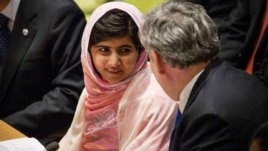 Malala Yousafzai speaks to former British PM Gordon Brown before speaking at the U.N. Youth Assembly, July 12, 2013.