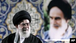 FILE - Iran's Supreme Leader Ayatollah Ali Khamenei delivers speech to paramilitary Basij force, saying pressure from economic sanctions will never force country into unwelcome concessions in nuclear negotiations, Tehran, Nov. 20, 2013.