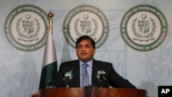 FILE - Pakistan's Foreign Ministry spokesman Mohammad Faisal briefs journalists in Islamabad, Pakistan, Feb. 4, 2018.