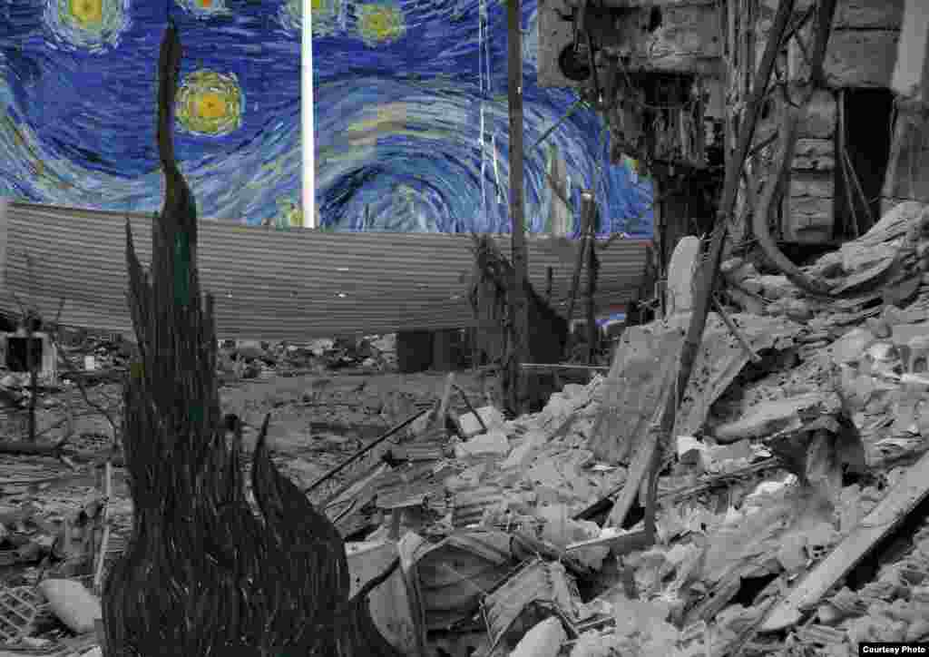 """""""Starry Night"""" by Vincent Van Gogh lurks behind the tin, steel and concrete remains of a neighborhood in Daraya. By Tammam Azzam."""