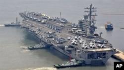 ກໍາປັ່ນບັນທຸກເຮືອບິນລົບ USS Ronald Reagan ຂອງສະຫະລັດ.
