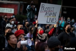 FILE - People take part in a Stop Asian Hate rally at Times Square in New York City, April 4, 2021.
