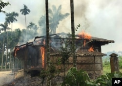 Houses are on fire in Gawdu Zara village, northern Rakhine state, Myanmar, Sept. 7, 2017.