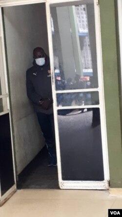 Tendai Biti in handcuffs