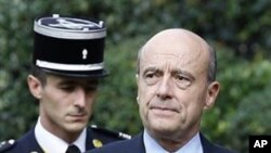 Newly named Defense Minister Alain Juppe arrives during the handover ceremony with France's outgoing Defense Minister Herve Morin, unseen, in Paris, 15 Nov 2010