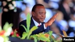 FILE - Kenya's President Uhuru Kenyatta reacts as he attends Mashujaa (Heroes) Day at the Nyayo National Stadium in Nairobi, Oct. 20, 2013.