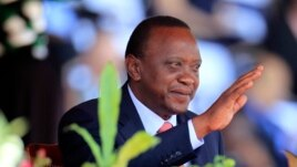 Kenya's President Uhuru Kenyatta reacts as he attends Mashujaa (Heroes) Day at the Nyayo National Stadium in capital Nairobi, Oct. 20, 2013.