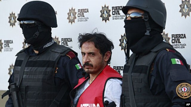 Baltazar Saucedo Estrada (C) is presented to the media at police headquarters in Monterrey, January 6, 2012.