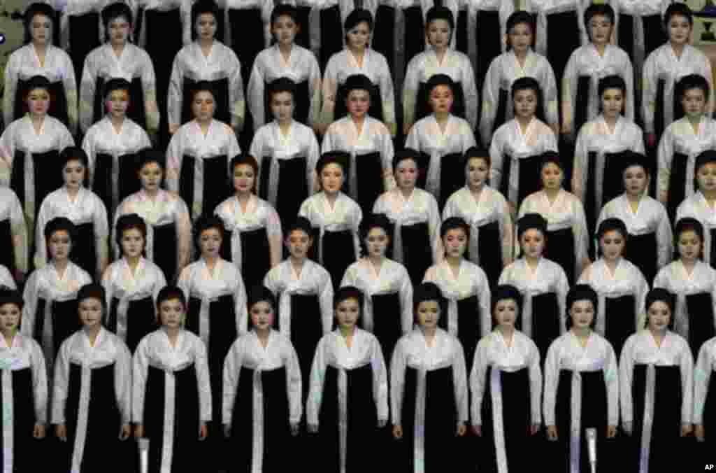 North Korean performers pause before singing at the Pyongyang indoor gymnasium to commemorate late president Kim Il Sung's 100th birthday in Pyongyang, North Korea, Monday, April 16, 2012. (AP Photo/Vincent Yu)