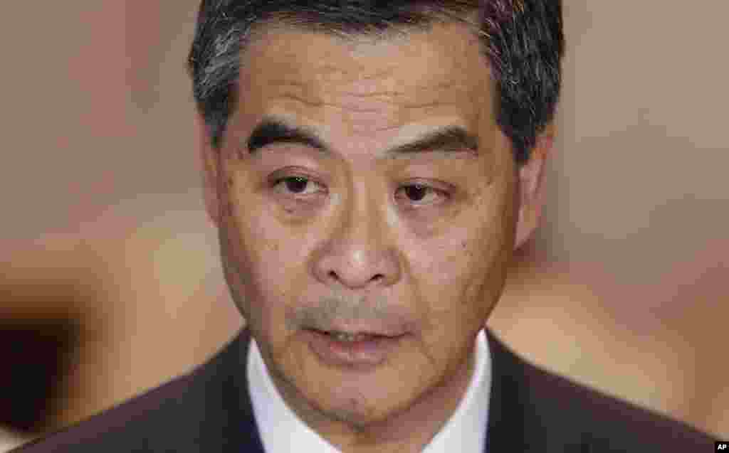 Hong Kong Chief Executive Leung Chun-ying speaks to the media after a presentation ceremony in Hong Kong, Oct. 15, 2014.