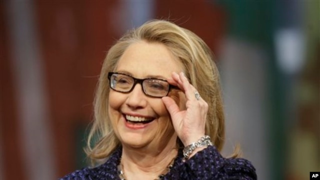 Secretary of State Hillary Rodham Clinton adjusts her glasses during a Global Townterview at the Newseum in Washington, January 29, 2013.