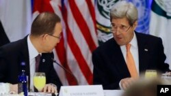 U.N. Secretary-General Ban Ki-moon, left, and U.S. Secretary of State John Kerry speak before a meeting of the International Syria Support Group at a hotel in New York, Dec. 18, 2015.