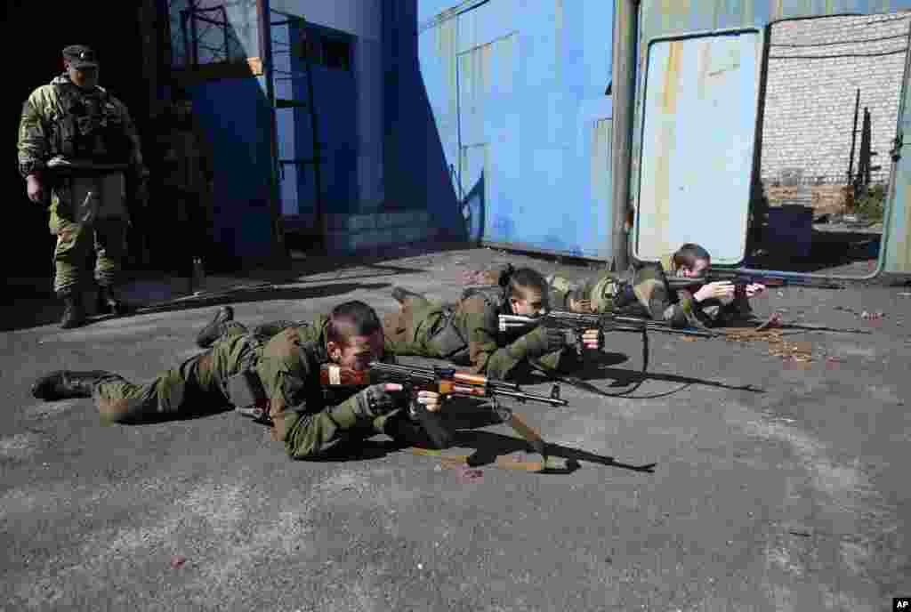 Young pro-Russian rebels train in the city of Donetsk, eastern Ukraine, Sept. 29, 2014.