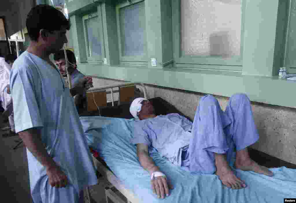A survivor of an earthquake receives medical treatment at a hospital in Jalalabad province, Afghanistan, April 24, 2013.