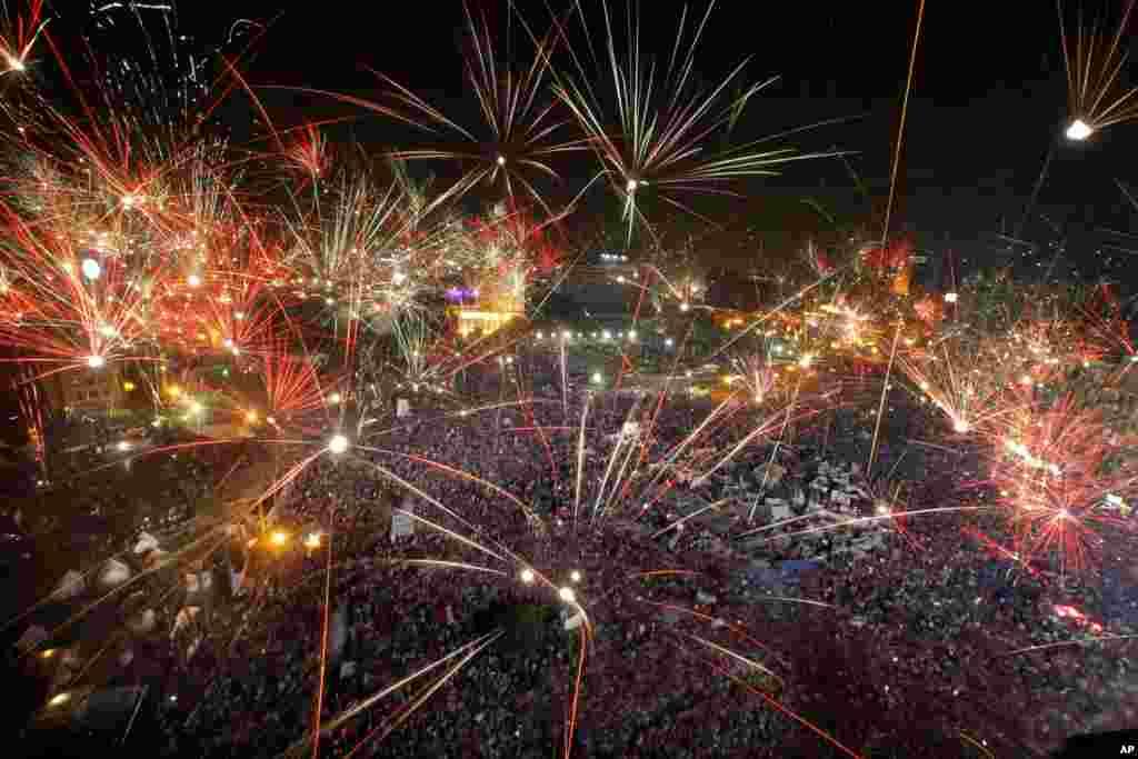 Fireworks light up the sky opponents of Egypt's Islamist President Mohamed Morsi celebrate in Tahrir Square in Cairo, July 3, 2013.
