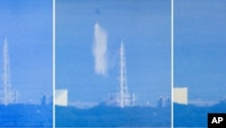 Screen grabs from Japanese national broadcaster NHK show a Japanese military cargo helicopter dumping water onto reactor number 3 at the stricken Fukushima nuclear power plant on March 17, 2011
