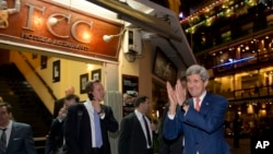 U.S. Secretary of State John Kerry returns a warm greeting from a crowd as he leaves the Foreign Correspondents Club Restaurant in Phnom Penh, Cambodia, Monday, Jan. 25, 2016. (AP Photo/Jacquelyn Martin, Pool)