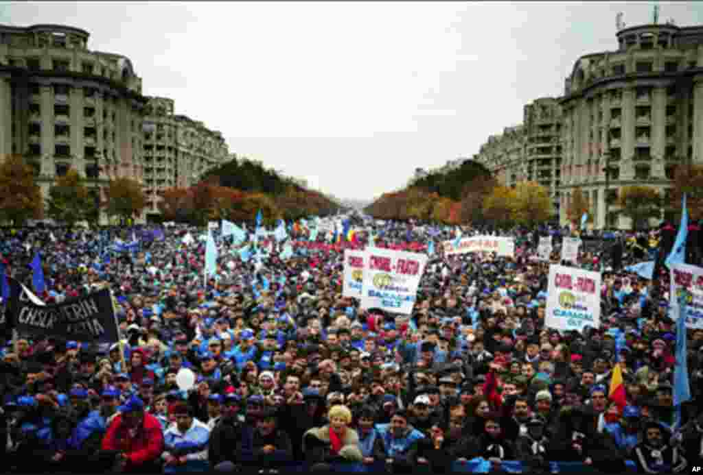 Romanian union members shout anti-government slogans in front of the Romanian Parliament in Bucharest. About 80,000 union members were expected to take part in the demonstration against austerity measures taken by the Romanian government.