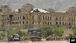 Afghan and foreign investigators inspect the site of a suicide attack in Kabul on , 18 May 2010