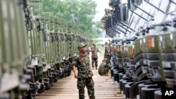 FILE PHOTO - A Cambodian army soldier looks at Chinese military vehicles displayed before a handover ceremony at a military airbase in Phnom Penh, Cambodia.